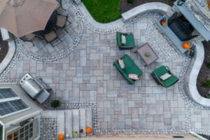 patio made of pavers with fireplace and furniture